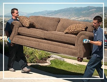 RC Willey delivery team carying a new couch to a home