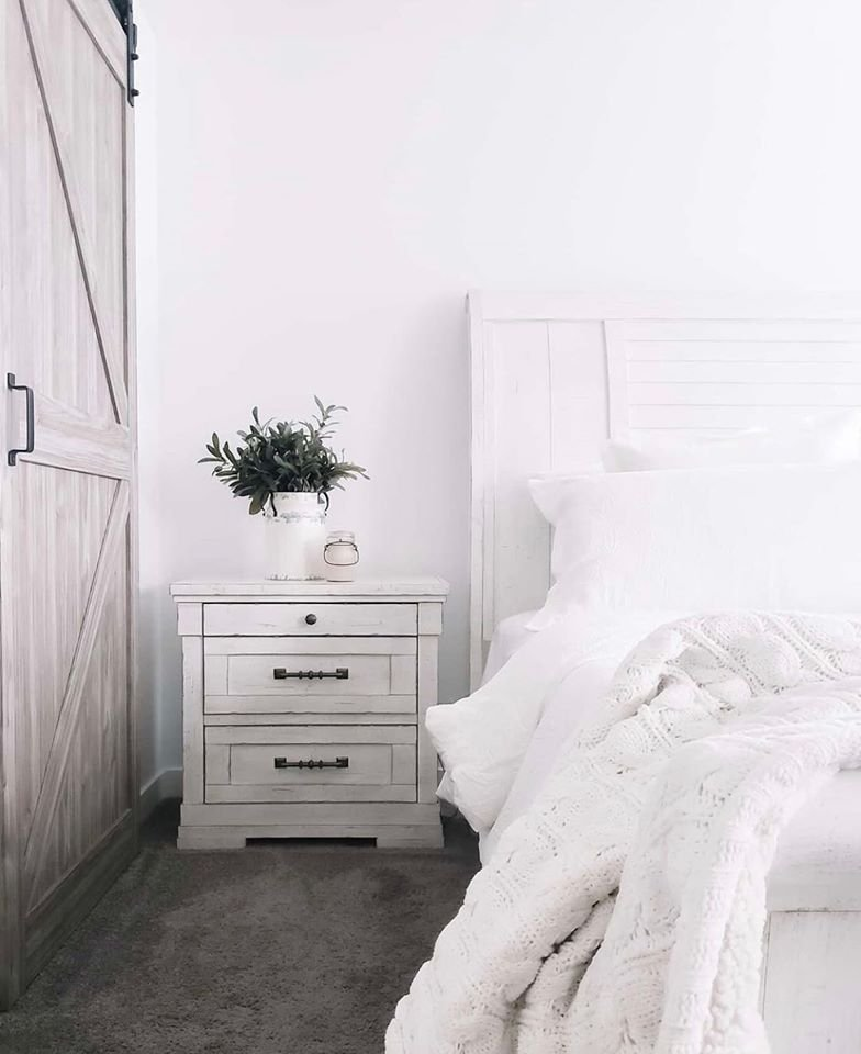 White farmhouse bed and nightstand