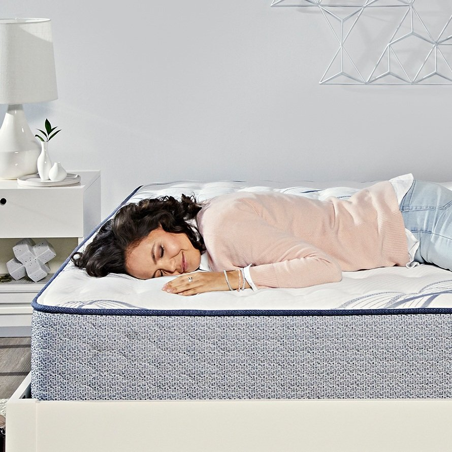 a woman resting peacefully on a Serta mattress