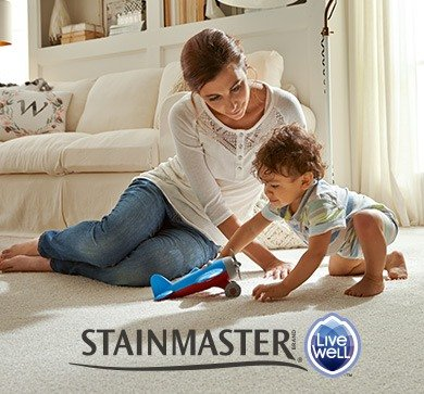 Mother and toddler playing with a toy airplane on Stainmaster® LiveWell™ carpet
