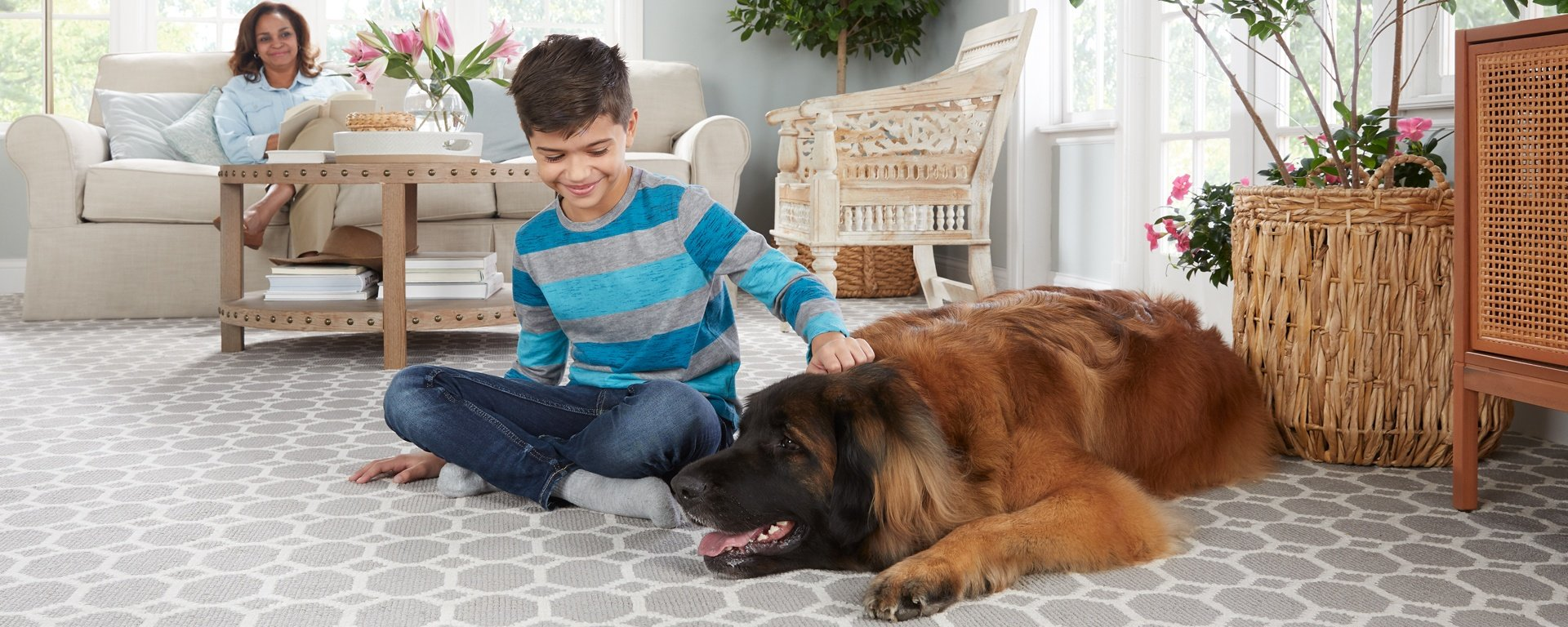 Stainmaster Pet Protect carpet with a boy and his big dog sitting on the floor