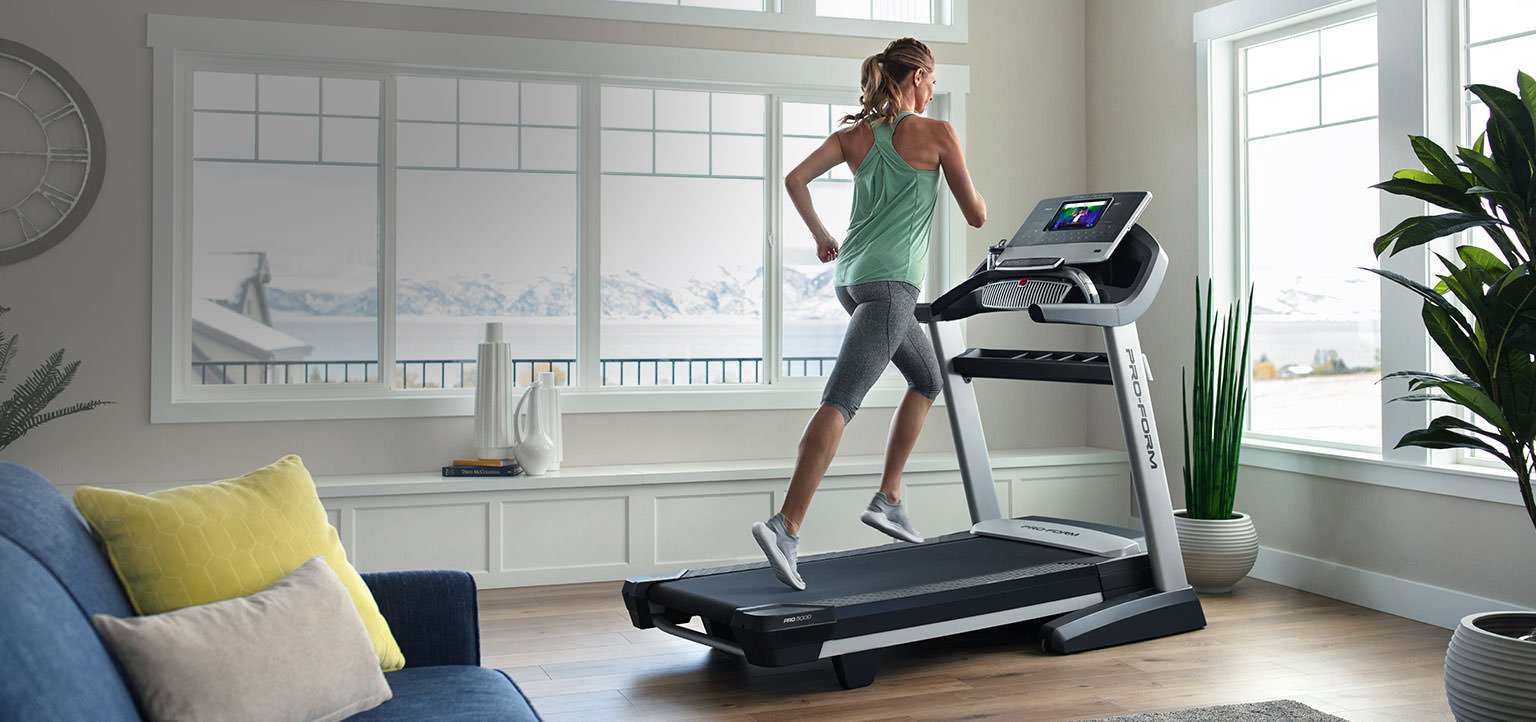 woman running on proform treadmill in home