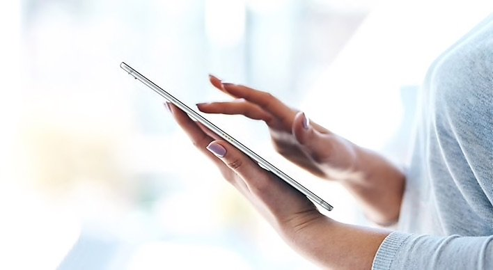 woman touching ultra light tablet