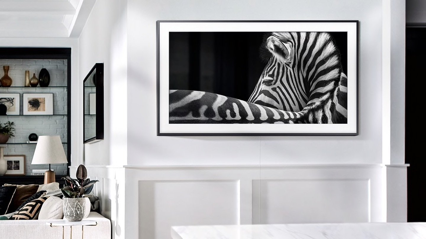 Samsung The Frame TV hanging on wall with zebra