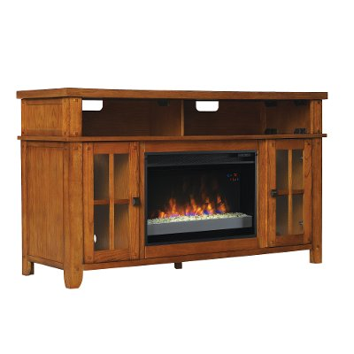 RC Willey offers the Dakota 60 Inch Oak TV stand with fireplace which features an elegant arts & crafts styling with tempered glass windowpane doors and antique brass hardware. Functionality is built-in with the open
