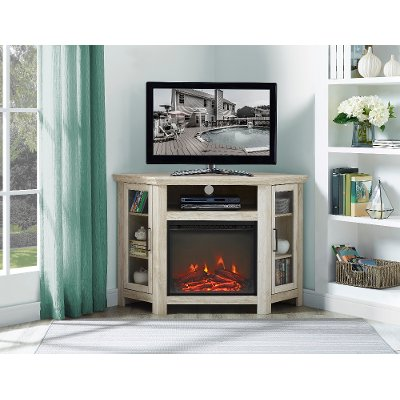 Wondering what to put in the corner of your room? Adding this 48 inch white oak corner TV stand with fireplace from RC Willey will dress up any room in your home. Its corner design makes this the perfect space saving unit while creating a warm