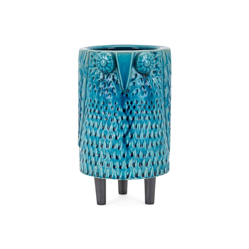 The owl has long been a symbol of higher wisdom and now it's a symbol of high style. Now at RC Willey, this owl vase is made of handcrafted ceramic and finished in a luxurious blue glaze. Display this in a focal area of your home like a front entryway table that needs something to finish the look. The black legs are the perfect complement.
