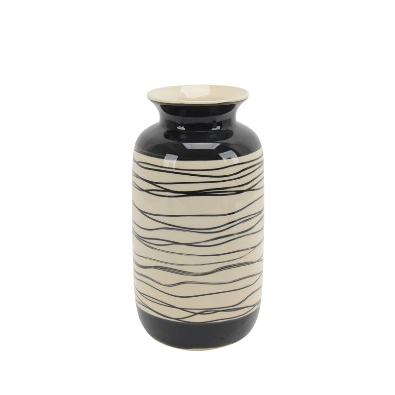 """This 10"""" vase from RC Willey is finished in a beautiful black and white. The color combination and design offer a charming style."""