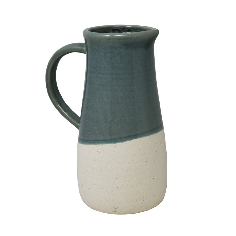 Two-toned green and white, this ceramic pitcher from RC Willey will be the perfect accent on a shelf, mantel or entryway table. Accessories are a fun way to add your own sense of style to your decor.