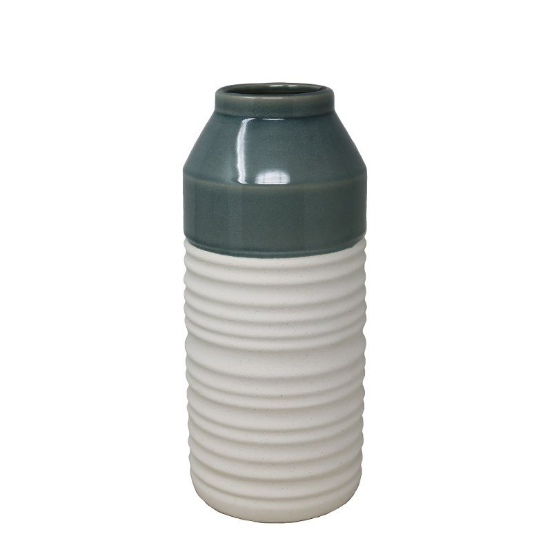 This ceramic vase from RC Willey will add color to your shelf, mantel or an entryway table. Two-toned in green and white, this accessory will fit in with your decor no matter what your style is.