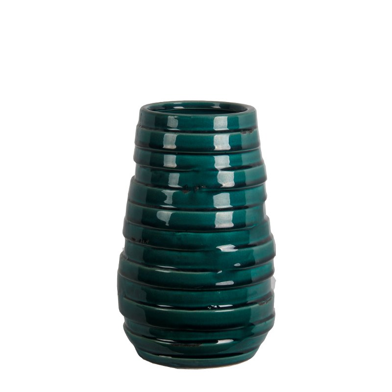 This 10.5-inch vase from RC Willey will make a gorgeous focal point in your home. Finished in a green ceramic, this vase has a ribbed detailing that adds texture. Display this on an accent table.
