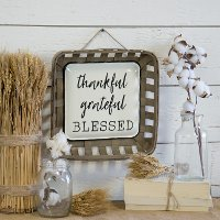 Brown, White and Black Thankful Wood and Metal Sign
