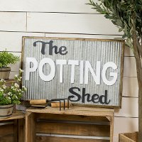 White, Black and Metal Potting Shed Sign