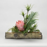 Faux Pink King Protea with Palm Fronds Arrangement on Cement Log
