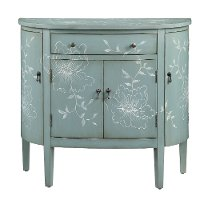 Teal Cabinet With Curved Doors And White Floral Graphics
