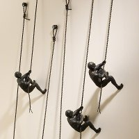 Assorted Bronze Climbing Man Wall Mount